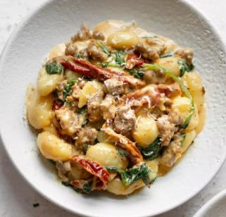 Gnocchi Con Salsiccia.Italian potato pasta tossed with Italian Sausage and spinach in a garlic cream sauce.